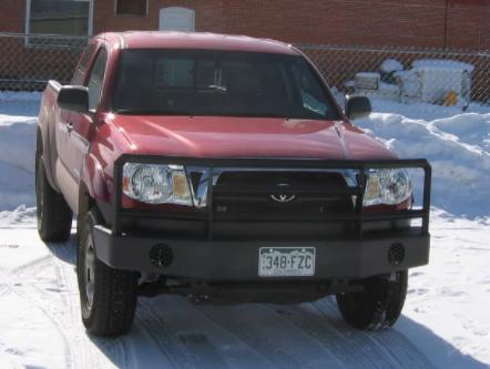 Custom TRD bumper on red truck